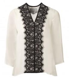 Женская кремовая блузка с вставкой из однотонной черной ткани